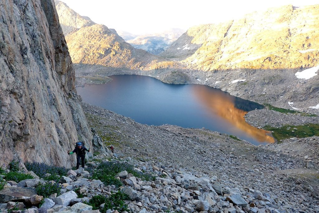 Early morning climb of Douglas Pass ~ The suggested route is next to the wall