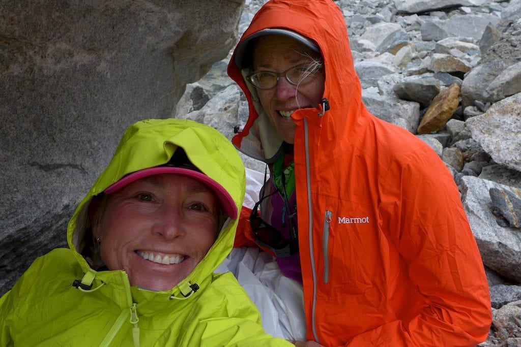 Why Not and I hunkered down under a rock overhang during a short rain storm.